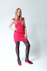 Pretty blond-brown lady wearing fashionable pink dress