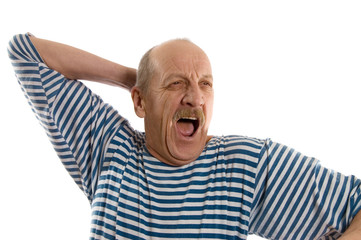 elderly  man in a stripped vest yawns