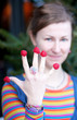 Beautiful young girl in bright clothes poses as Amelie with rasp