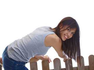 girl reached the other side of the fence