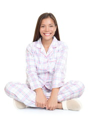 Woman smiling sitting in pajamas