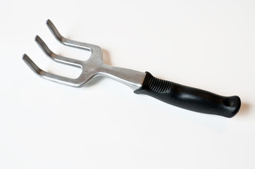 Hand sized garden fork isolated on white background