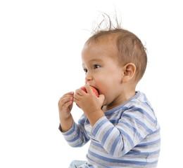 cute boy eating an apple