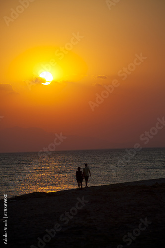 couple at the beach on sunset in turkey
