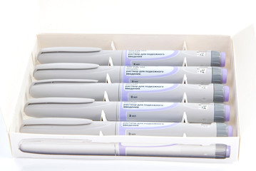 Diabetic insulin syringe injectors