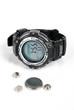 Leinwanddruck Bild - Button battery and wrist watch