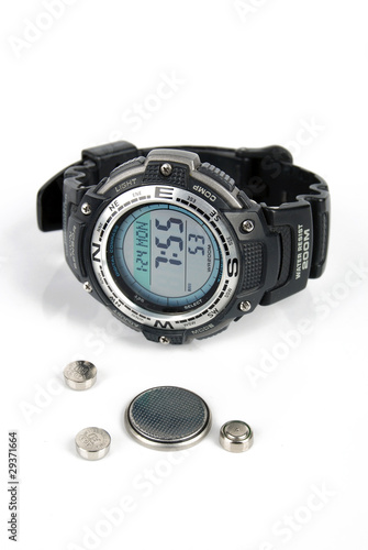 Leinwanddruck Bild Button battery and wrist watch
