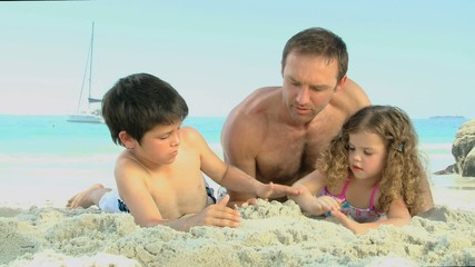 Man and his childs building a sand castle