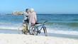 Elderly couple looking at the horizon after a ride bike