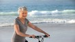 Elderly woman looking at the camera with a bike