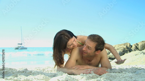 Woman lying down on her husband back