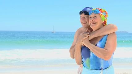 Elderly man hugging his wife