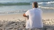 Elderly man looking at the ocean