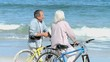 Elderly man talking with his wife after a bike ride