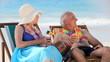 Elderly couple drinking cocktails