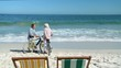 Elderly couple with bikes talking