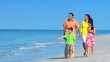 Happy Family Enjoying the Beach filmed at 60FPS