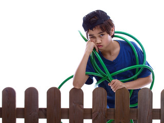 child rolling up the water hose