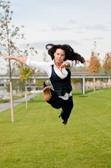 Woman in gymnastics jump outdoors