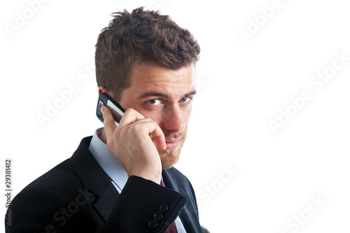 Confident businessman talking at the phone isolated on white