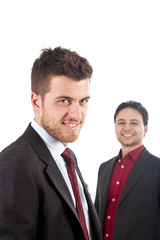 Two confident smiling businessmen isolated on white