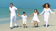 Attractive Young Family Beach Vacation filmed at 60FPS