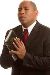 Holding the Bible in Prayer