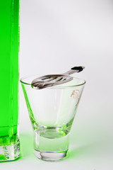Glass with absinthe spoon