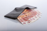black leather wallet with bills
