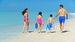Healthy Family in Swimwear on the Beach filmed 60FPS
