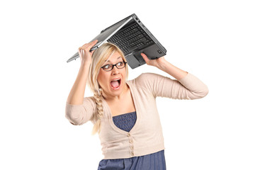 A scared female covering her head with a laptop