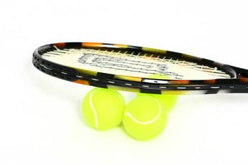 tennis racket and 3 tennisballs