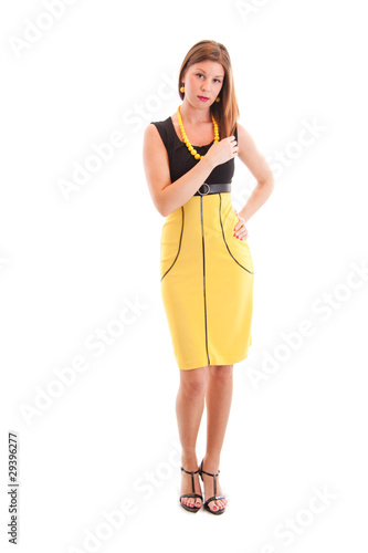 Full-length portrait of sexy young woman in yellow dress