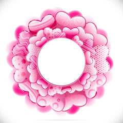 Round frame made of hearts and adorned with various ornaments.