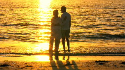 Contented Senior Couple Watching the Sunset filmed 60FPS