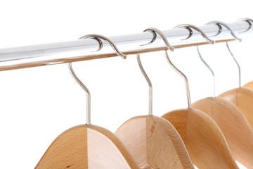 coat hangers on a clothes rail, close up