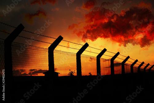 fence under sleeping sunset