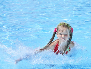 Child swim in swimming pool.