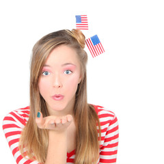 AMERICAN  GIRL BLOWING WISHES OR KISSES CELEBRATING 4TH OF JULY