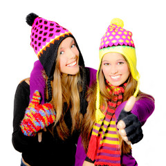 Happy smiling winter hat young women or girls