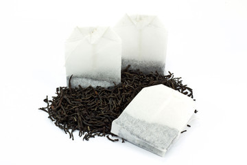 Tea bags and dried tea leaves