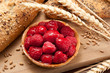 Raspberry cake with traditional bread background