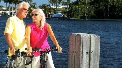Seniors on Bicycles Resting by a Marina filmed at 60FPS