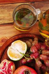 sweet fruits with tea pot