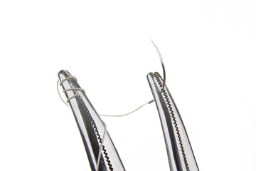 Forceps holding suture