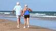 Healthy Retired Couple on a Beach in Sportswear filmed 60FPS