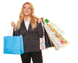 Frau beim Einkaufen mit vielen Einkaufstaschen