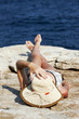 woman with hat sunbathing