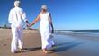 Seniors Walking Barefoot on the Beach filmed at 60FPS