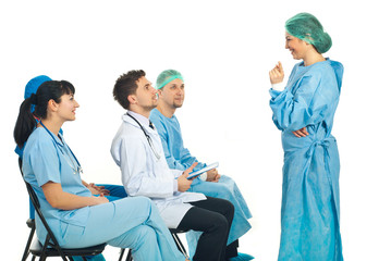 Surgeon woman having discussion with doctors